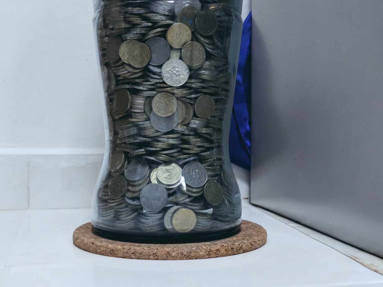 My Parents Used to Save Coins in a Glass Bottle. It Taught Me Everything About Life
