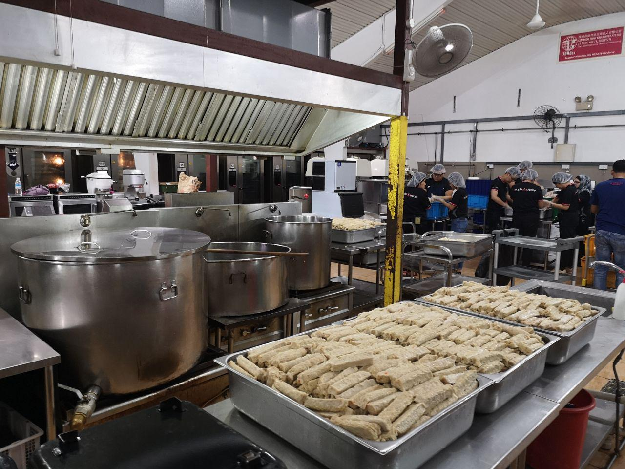 The kitchen, where volunteers assist cooks with the preparation of meals.