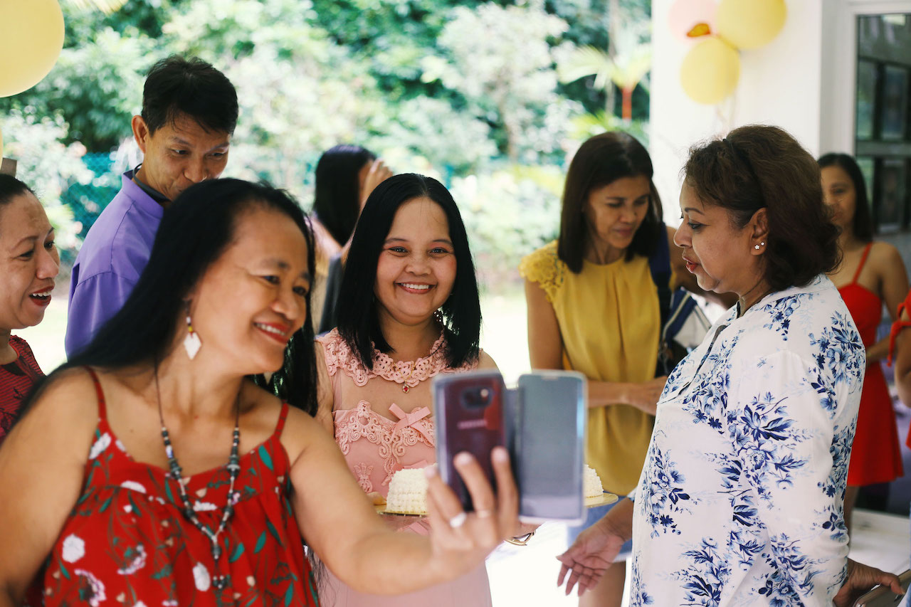 After 27 Years in Singapore, This Domestic Helper Wants Fellow Filipinos to Spend More Wisely