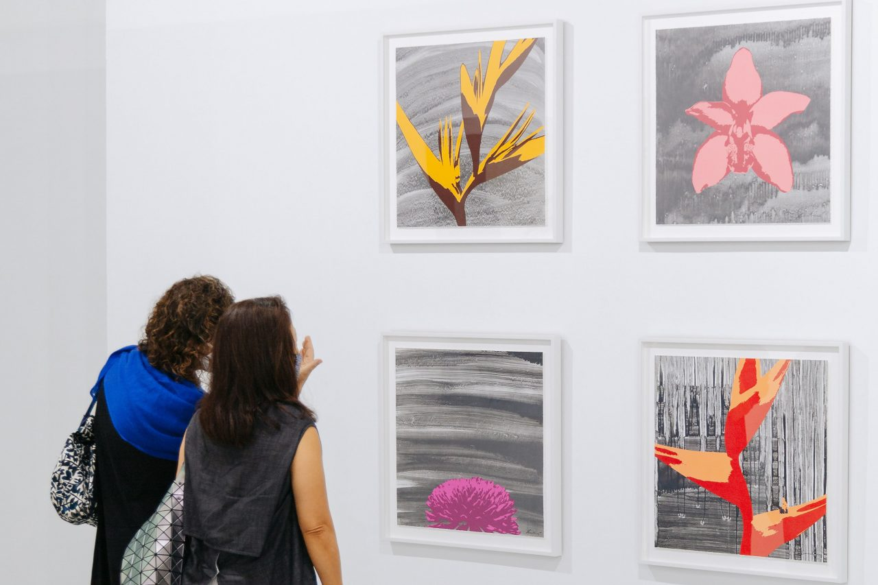 """From upper left, clockwise: Russel Wong, """"Heliconia"""", """"Cymbidium Orchid"""", """"Heliconia Wagneriana"""", """"Chrysanthemum"""", 2020. Photolithography on paper, edition of 12, 60 x 60 cm, presented by STPI – Creative Workshop & Gallery. Photo by Toni Cuhadi, courtesy of S.E.A. Focus, Singapore"""