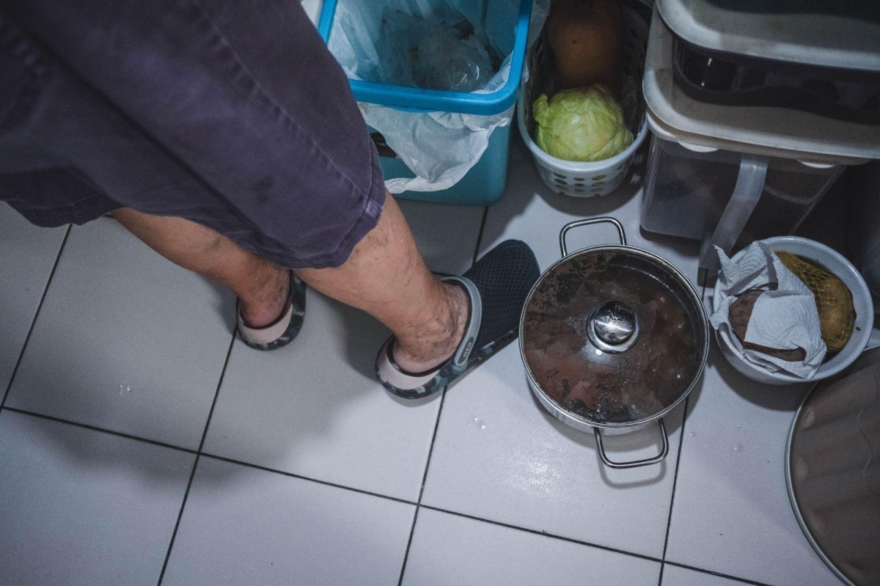 With limited stovetops, pots are sometimes placed on the floor.